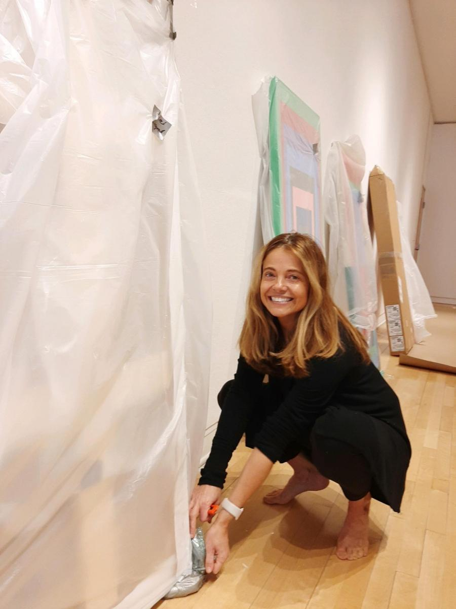 Michelle Bowen sets up her gallery